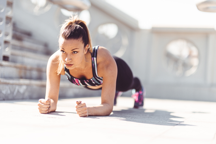 fitness woman on a plank pose